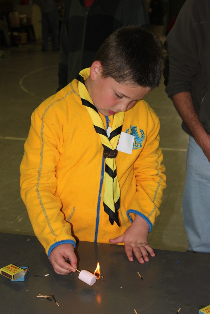 Randburg District Cub Skills Day: Sebastian Vladimirov toasting a marshmallow over a burning peanut