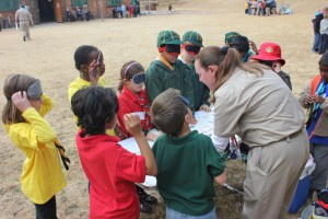 Randburg District Cub Skills Day: Cubs blindfolded for a Kim's game
